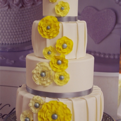 White Pleated 4 Tier Cake Yellow Rosettes Bridal Show Sample Cake