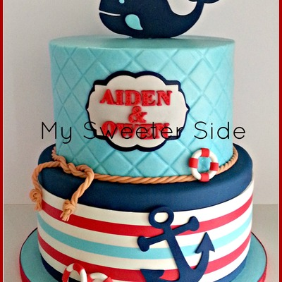 Happy First Birthday Aiden And Owen Top Tier Is Covered In Buttercream Bottom Tier Is Covered In Navy Fondant With A Modeling Chocolate