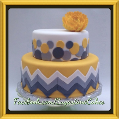 Chevron Print Wedding Cake With Sporadic Circles Covered In Fondant With A Gumpaste Flower Dusted In Luster Gold Luster