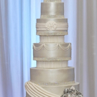 Buttercream Cake Airbrushed With Pearl Dust Swags And Pleats Between Tiers Are In Fondant With Help Of A Pasta Machine Gumpaste Flowers A