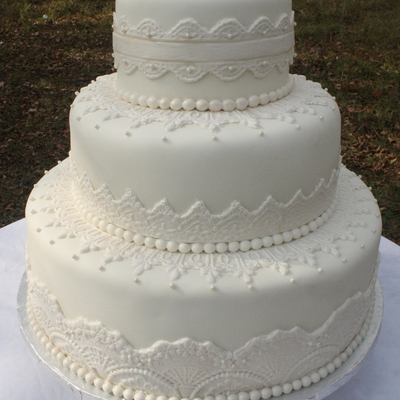 Elegant White Lace & Pearls Wedding Cake