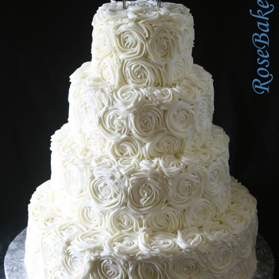 Buttercream Roses Wedding Cake With Blue Love Birds