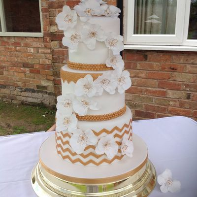 White And Gold Orchid And Chevron Weeding Cake