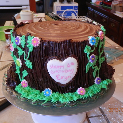 Tree Stump With Butter Cream Frosting And Sugar Flowers With A Fondant Heart For A Woodland Fairy Theme Birthday Texture Was Gotten By Us on Cake Central