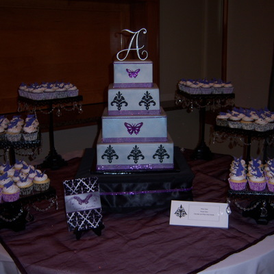 4 Tier Square Dummy Cake Designed To Match Their Invitations 3 Flavors Of Cupcakes With Fondant Butterfly Toppers Colors Where Silver Pur
