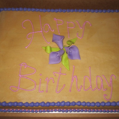Half Sheet Cake Covered In Peanut Butter Buttercream With Fondant Lillies And Leaves