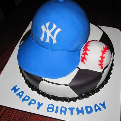 Cake For A Soccer Player Who Loes The Yankees Bottom Is A 10 Round Covered In Buttercream With Black Fondant Accents Hat Is A 6 Round