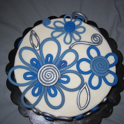8 Cake Covered In Buttercream With Fondant Accents Some Painted With Silver Luster Dust