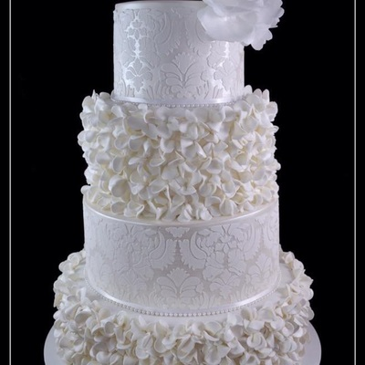 White And Pearl Wedding Cake With Ruffled Flowers