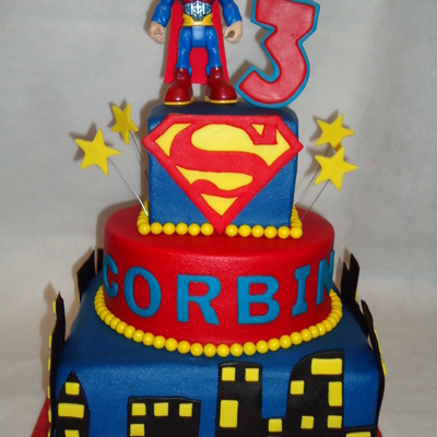 3 Tier Vanilla Cake With Buttercream And Fondant Accents I Used A Superman Toy On Top This Was A Cake I Did For The Icing Smiles Organiza