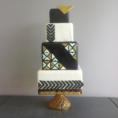 Geometric Black, White, And Gold Wedding Cake