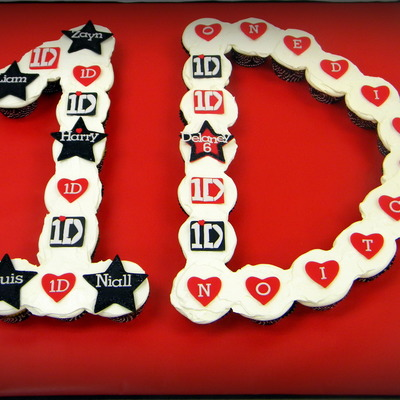 One Direction Cupcake Cake For A Special Little Girl Cupcakes Are Chocolate And Yellow Topped With Whipped Cream Icing The Toppers Are