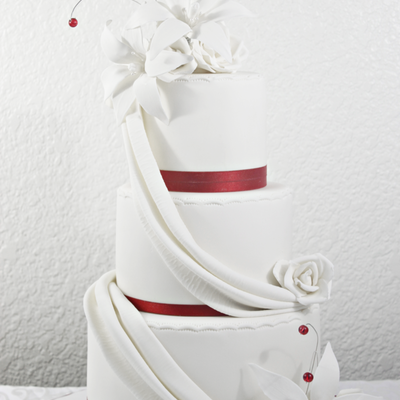 Red & White Wedding Cake W/ Drapes And Lilies