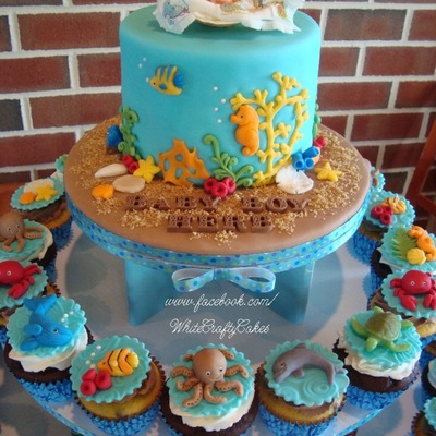 I Made This Cake And Cupcake Tower For A Under The Sea Themed Baby Shower Sea Creature Toppers Are Marshmallow Fondant The Baby In A Cla