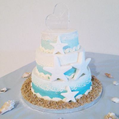 Beach Sea Star Cake Bottom And Top Tiers Are French Vanilla Cake With Fresh Strawberry Filling Middle Tier Is White Cake With Fresh Raspb