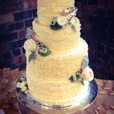 Ruffled Buttercream 4 Tier Cake With Winter Flowers And Gold Sugar Leaves