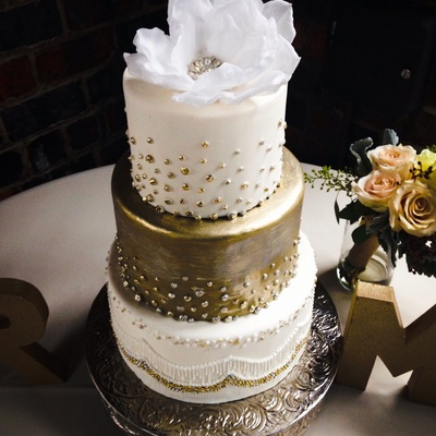 Metallic Silver And Gold Three Tier Wedding Cake With A Jeweled Wafer Paper Flower