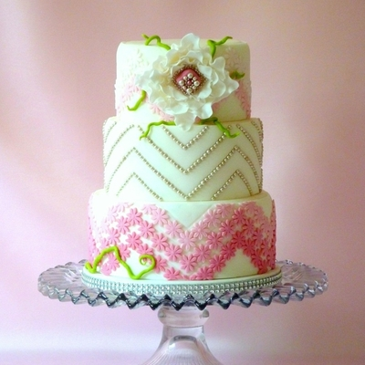 White Tiered Fondant With Ruffled Flower And Pink Ombre Flower Chevron
