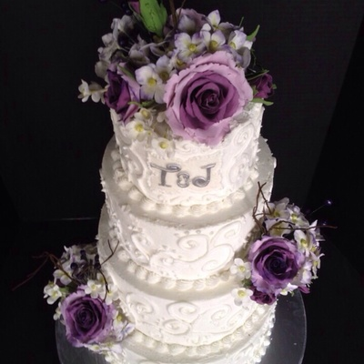 Buttercream Scroll Cake With Purple Roses Hydrangeas And Berries