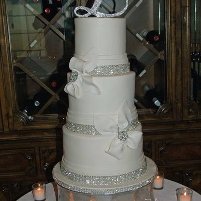 Elegant White Bow And Bling Wedding Cake