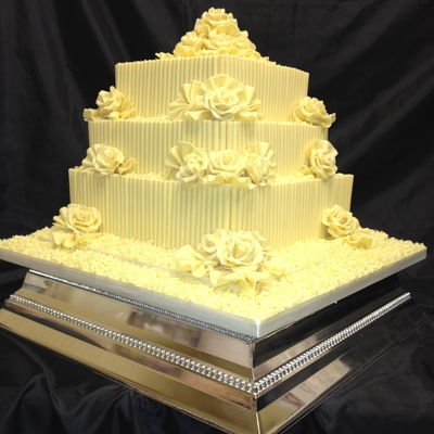 3 Tier White Belgium Chocolate With Fans And White Roses White Curls Wedding Cake