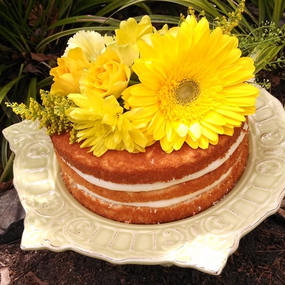 Fresh Yellow Flowers Top This Naked Cake