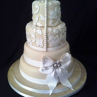 Champagne Coloured Fondant Decorated With Lace And A Gum Paste Bow