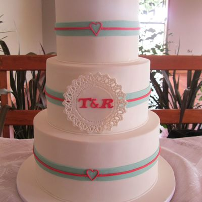 3 Tier Wedding Cake With The Design Taken From The Couples Colour Scheme And Invitations Handcut Doily And Fondant Ribbons The Hearts Wer