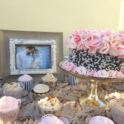 A Cutting Cake And Cupcake Display For A Wedding