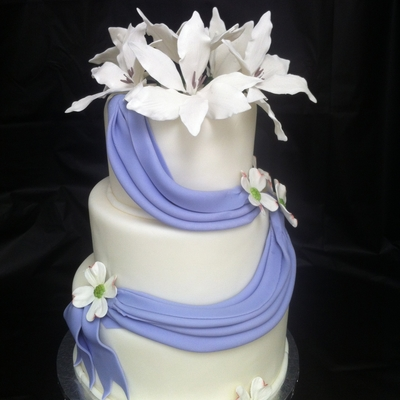 Lily And Dogwood Purple Draped Wedding Cake