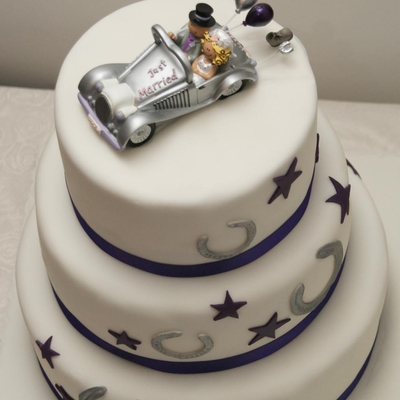 Lucky Horseshoe And Purple Star Wedding Cake on Cake Central