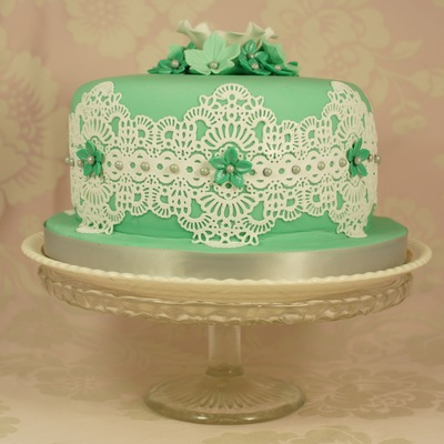 A Six Inch Birthday Fruit Cake Decorated With Cake Lace And Sugar Flowers