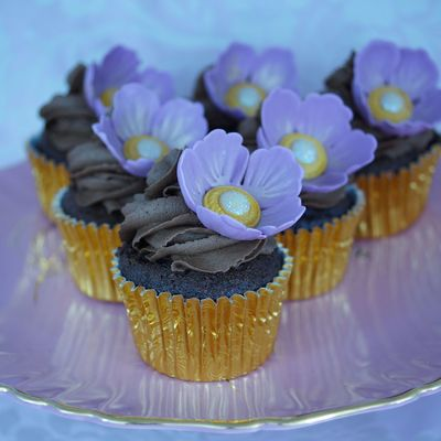 Chocolate Cupackes Topped With A Chocolate Buttercream Swirl And A Jewelled Centre Sugar Flower