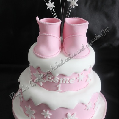 A Winter Themed Cake With Sugar Paste Ugg Baby Boots