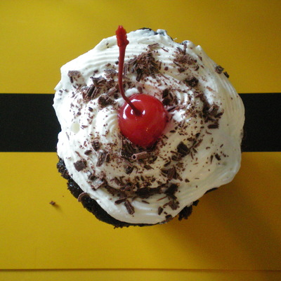 Black Forest Cupcake With Cherry Cherry Brandy Filling And Whipped Cream Frosting With Shaved Chocolate Maraschino Cherry