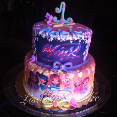 Winx Faires Chocolate Cake With Nutella Filling And Chocolate Ganache Used Frosting Sheets With Design On Them on Cake Central