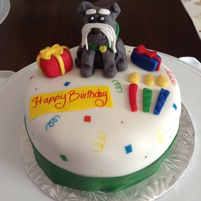 Birthday Cake With Fondant Decorations And Featuring Ted The Party Schnauzer