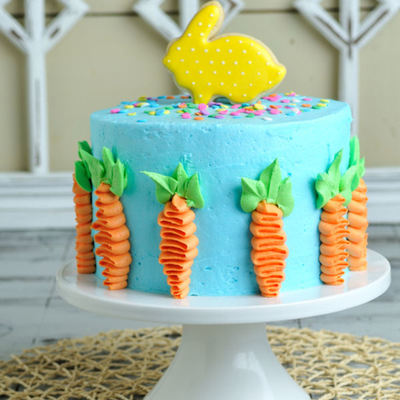 Pretty Easter Cake Decorated With Buttercream Carrots And Bunny Cookie Topper on Cake Central