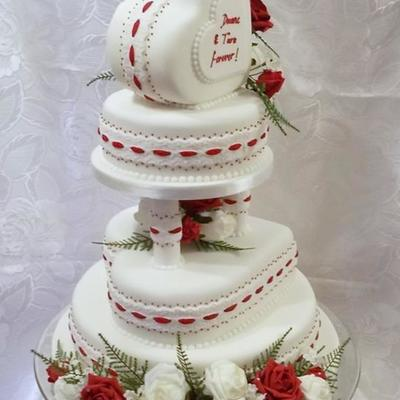 4 Tier Wedding Cake Red And Ivory Colour With A Heart Theme Edible Lace With Hand Painted Highlights And Royal Icing Pearls Its The Fi