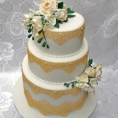 3 Tier Wedding Cake With Gold Edible Lace And Hand Made Sugar Flowers Roses And Freesia Made By Veritys Creative Cakes on Cake Central