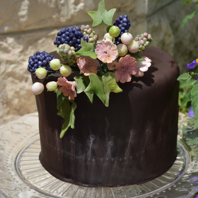 Sugar Berries And Flowers On A Gluten-Free Cake