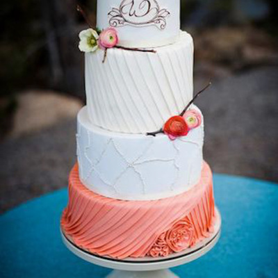 Vintage Coral And Ivory Wedding Cake With Pleats And Fresh Flowers