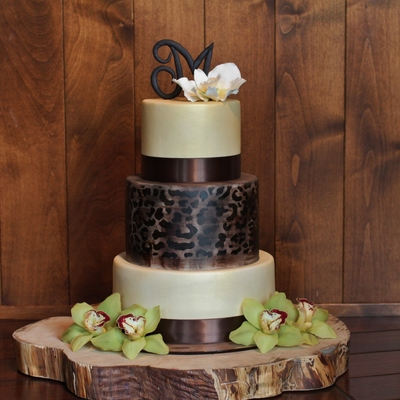 Classy Woodsy And Elegant Leopard Print Wedding Cake With A Sugar Orchid And Monogram On Top By Sweet And Swanky Cakes