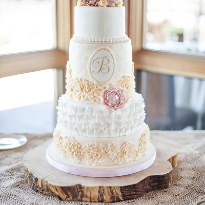 Romantic Wedding Cake With Lots Of Ruffles And Sugar Peonies And A Hand Painted Monogram By Sweet And Swanky Cakes
