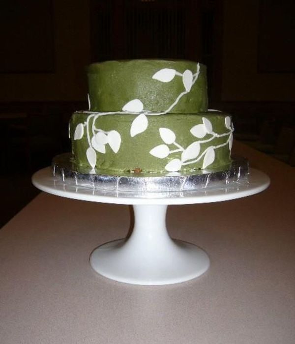 Green Buttercream With White Gum Paste Leaves