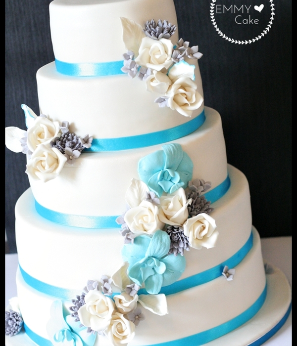 White Wedding Cake With Blue, Silver And White Sugar...