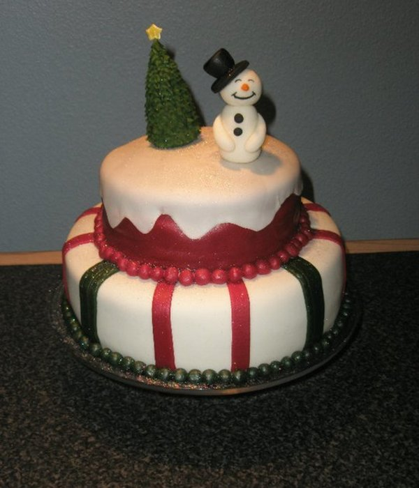 A Christmas Cake With A Snowman And A Christmas Tree