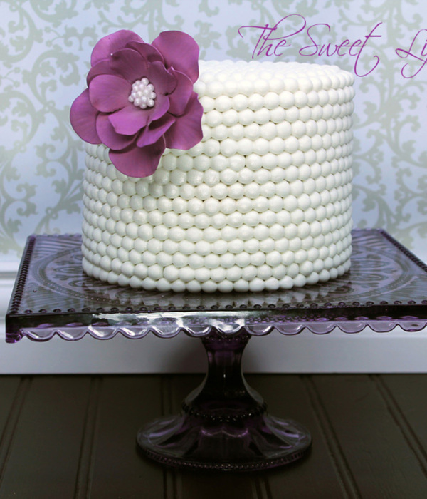 White Chocolate Cake Covered In Fondant Pearls With A Gum Paste Fantasy Flower