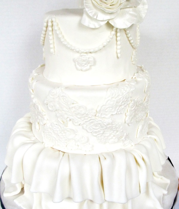Cake With Drape Ruffles And Lace