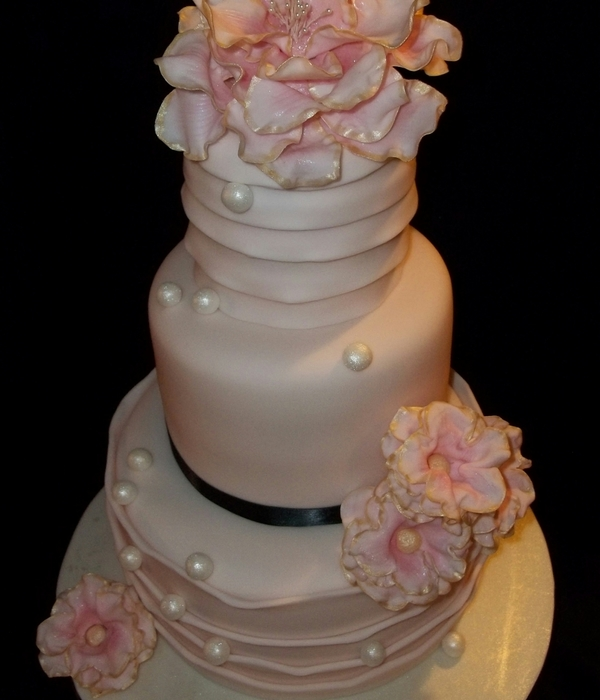 Three Tier Light Pink Cake With Sugar Flowers And Pearls I...